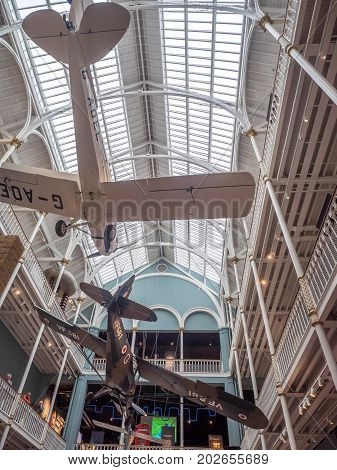 EDINBURGH, SCOTLAND - JULY 27: A gallery of the National Museum of Scotland with various planes on July 27, 2017 in Edinburgh Scotland. The National Museum is a landmark attraction in Scotland.