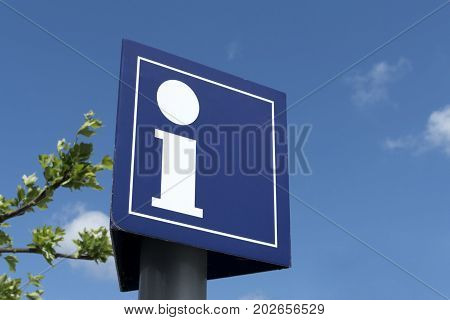 Information sign against blue sky in Summer
