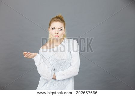 Confused Young Blonde Woman Looking Suspicious