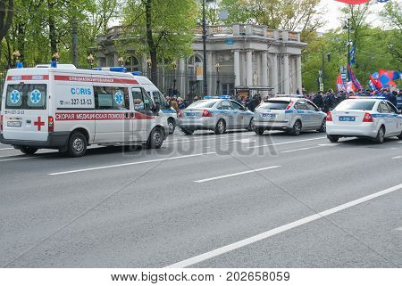 Sankt- Petersburg Russia - May 28 2017: Ambulance comes for police cars along the street of the city. Sankt- Petersburg Russia