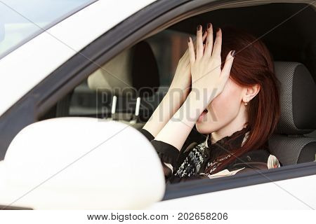 Stressed woman in a car