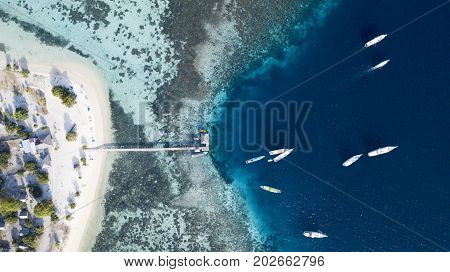Top view of tourist ships leaving jetty in the Kanawa island East Nusa Tenggara Indonesia