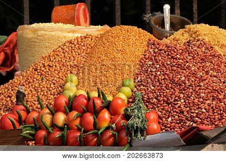 Colorful food displayed in an informal Indian market