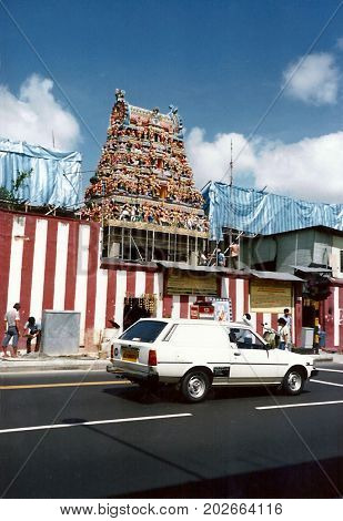 SINGAPORE / CIRCA 1990: The historic Sri Veeramakaliamman Temple, dedicated to the Hindu goddess Kali, is in the middle of Little India in the southern part of Singapore, undergoes repairs.