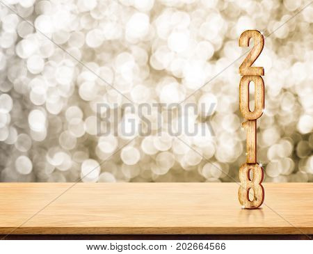 2018 new year wood number (3d rendering) on wood table with sparkling gold bokeh wallleave space for display or montage of product