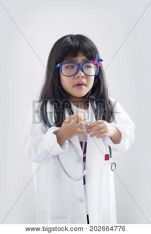 Asian Girl In Doctor Or Medical Suite Uniform