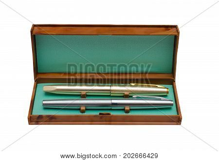 Ink pen in open vintage box isolated on white background.