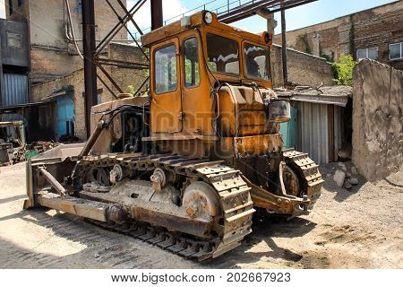 Bulldozer on the territory of concrete batching plant