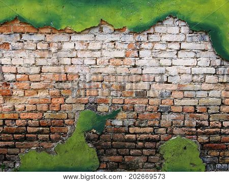 vintage background texture old masonry stone brown bricks on the ancient green cement with cracks.