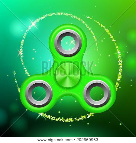 Green colorful spinner on an abstract background with green luminous backdrop. Abstract background with green luminous backdrop. Modern children's green toy - spinner.