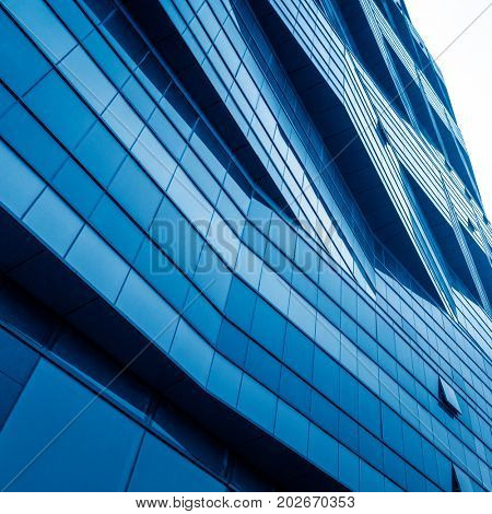 full frame of patterned wall,textured background,blue toned.