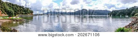 Panoramic landscape view of anchored boats at Whangaroa Harbour Northland New Zealand NZ