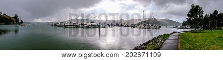 Panorama of Whangaroa Harbour boat marina on a rainy overcast day in Northland New Zealand NZ