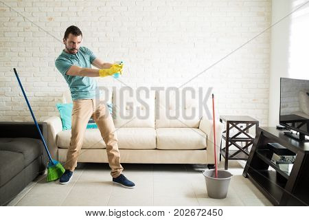 Playful Man Cleaning The House