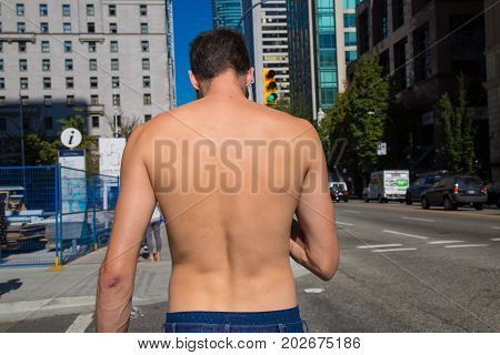 Concept freedom fit man topless downtown Vancouver Canada July 2017