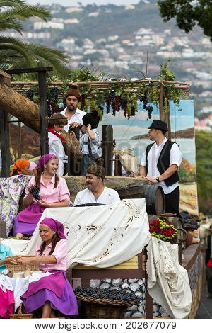 FUNCHAL MADEIRA PORTUGAL - SEPTEMBER 4 2016: Group of people in traditional costume durnig historical and ethnographic parade of Madeira Wine Festival in Funchal.
