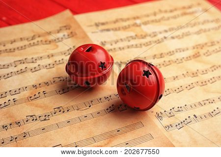 Decorative bells on music sheets. Christmas songs concept