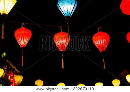 Colorful lanterns at the market street of Hoi An Ancient Town, UNESCO World Heritage Site. Vietnam.