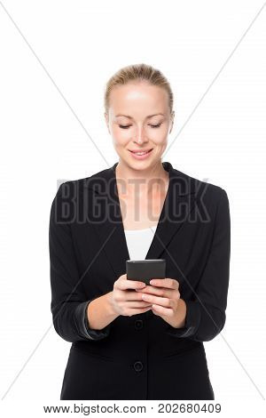 Beautiful young caucasian businesswoman in business attire using smart phone application. Studio portrait shot on white background.