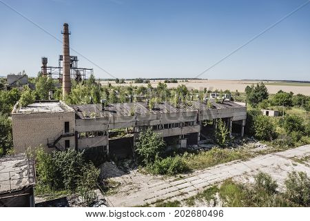 Aerial panoramic view to abandoned industrial area or zone, abandoned factory and warehouses, abandoned city and post apocalypse concept