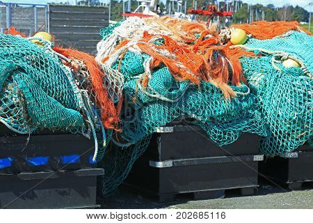 Fishing nets in the port of Loctudy Finistere Brittany France spread to dry