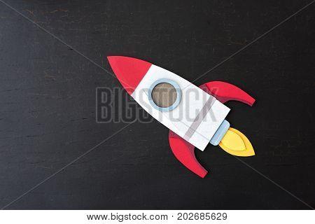 Rocket Spaceship Paper Craft Launch on Black Background