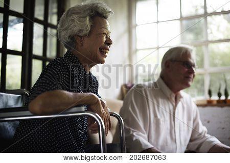 Side view of handicap senior woman on wheelchair