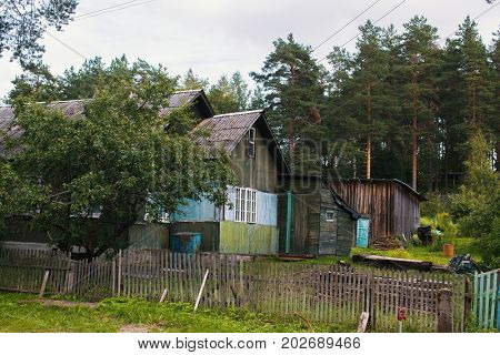 Typical residential wooden house in settlement in Leningrad region, Russia.