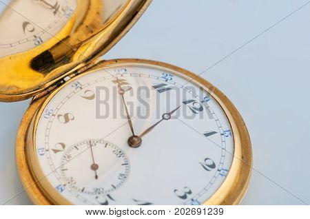 Retro vintage pocket gold watch with an open lid
