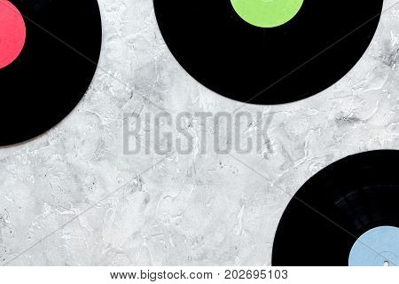songwriter or dj work place with notebook and vynil record on stone desk background top view mockup