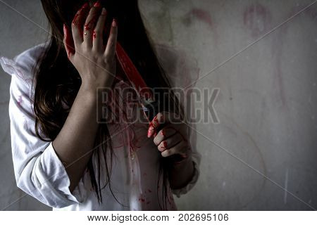 Ghost woman or zombie holding knife for kill with blood violence in house of ruin nightmare horror of scary fear on hell is monster devil in halloween festival copy space the right. poster