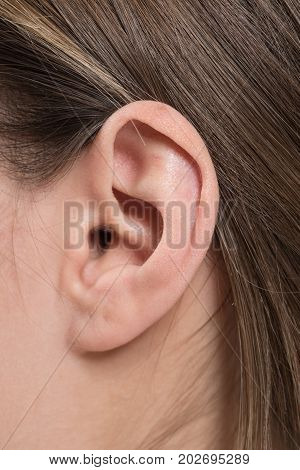 close up of woman ear.Ear healthcare concept.