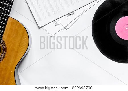 Desk of musician for songwriter work set with guitar and paper, vinyl record on white background top view mockup
