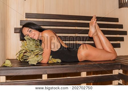 Girl Has Rest In The Sauna, In Steam Room