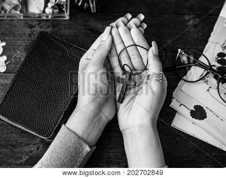 Holding Cross on Hands with Faithfulness