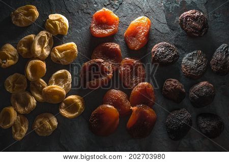 Background of multi-colored dried apricots close-up horizontal