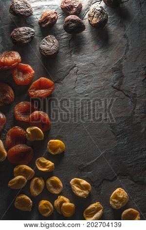 Frame of dried dried apricots on the left vertical