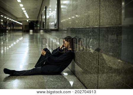Adult Woman Sitting Hopeless on The Floor