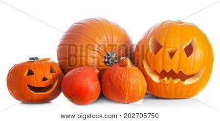 Halloween pumpkins, hand carved jack-o-lantern isolated on white background banner