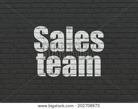 Marketing concept: Painted white text Sales Team on Black Brick wall background