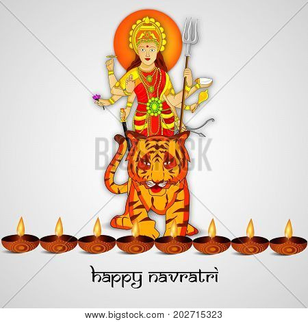 illustration of Hindu Goddess Durga on tiger and lamps with Happy Navratri text on the occasion of hindu festival Navratri