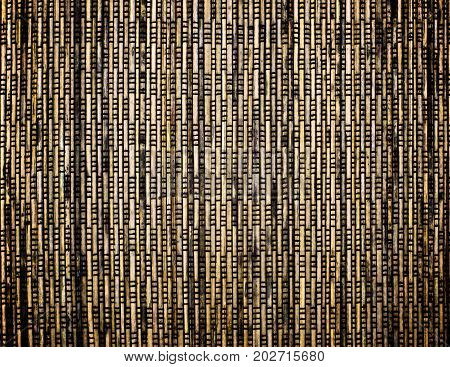 Background of Brown Yellow and Beige Wicker Straw Mat closeup