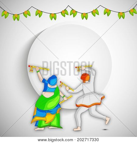 illustration of man and woman doing dandiya dance on the occasion of hindu festival Navratri