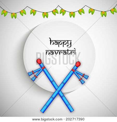 illustration of dandiya sticks with Happy Navratri text on the occasion of hindu festival Navratri