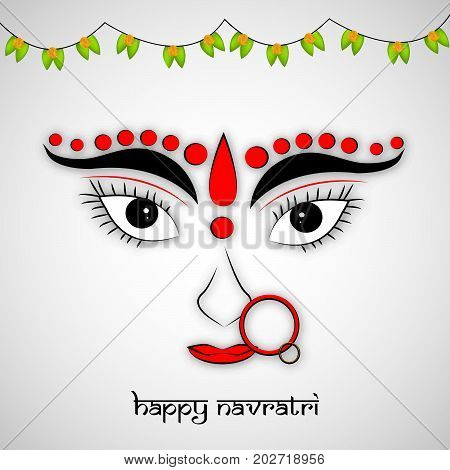 illustration of Hindu Goddess Durga face and decoration with Happy Navratri text on the occasion of hindu festival Navratri