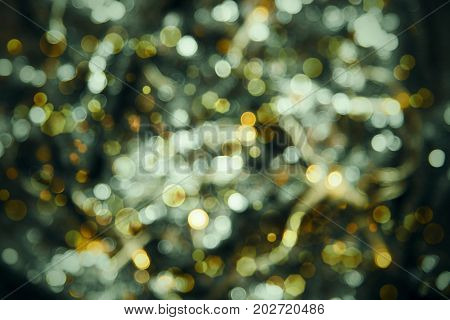 Glowing Greem Lights Texture With Bokeh Effect. Party, Celebration Or Christmas Background.