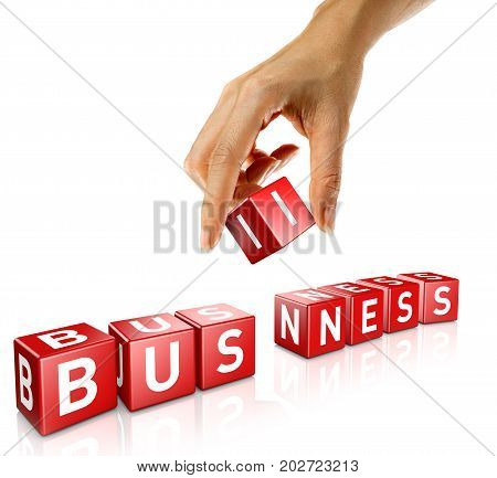 A woman's hand places a cube to form the word business. Isolated on a white background