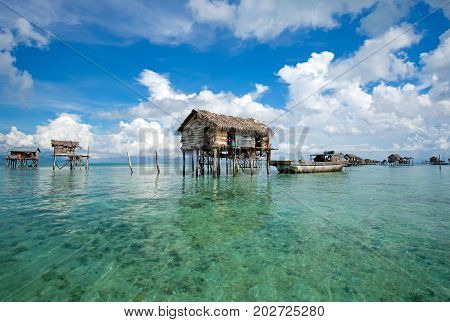 A Bajau floating village of stilted houses off the coast of Borneo in The Celebes Sea in the vicinity of Sipidan and Tun Sakaran Marine Park.