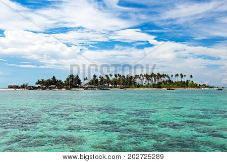 Beautiful Clear And Turquoise Colored Water Near Maiga Island Located In Semporna In The Vicinity Of