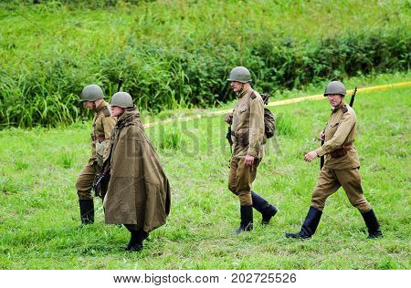 Soldiers with weapons.The VIII International Festival of Military History and remake for the battle `1944` 6.08.2016 in Valga, Estonia